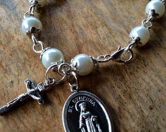 Prayer bracelet, handmade with white glass pearl beads, small crucifix and St Dymphna charm