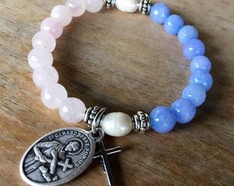 Handmade fertility prayer bracelet. Stretch yoga bracelet in rose quartz, dyed blue quartz & freshwater pearls with St. Gerard medallion