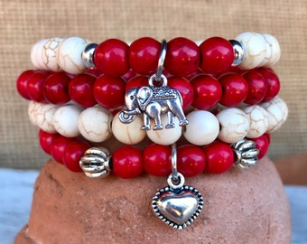 Boho stacker set of 4 stretch bracelets. Four stacking bracelets in red and white turquoise with puff heart and lucky elephant charms