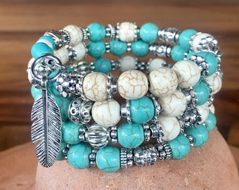 Handmade 4-wrap memory wire bracelet featuring turquoise and white magnesite beads with tibetan silver beads, spacers and feather charm