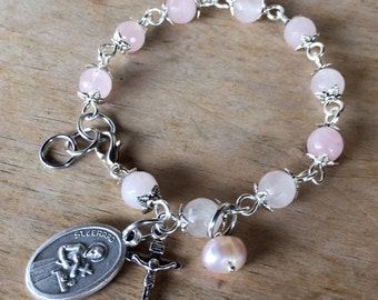Fertility prayer bracelet, handmade with rose quartz gemstone beads with Saint Gerard, crucifix and freshwater pearl drop.