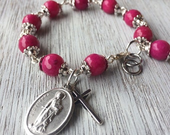 Prayer bracelet, handmade with dark fuchsia pink jade gemstone beads, small crucifix and St. Dymphna charm - or your choice of saint/charm