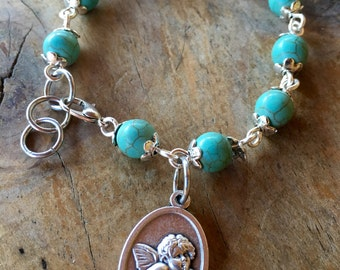 Handmade bracelet with turquoise beads and cherub medallion