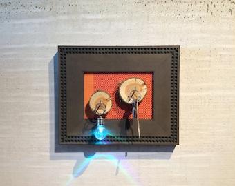 Key Hanger with Sliced Wood Stumps and Orange Textile Backdrop Houswarming Gift