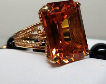 KAPOW 1970s Era 10K Yellow Gold Orange Cultured Sapphire Ring
