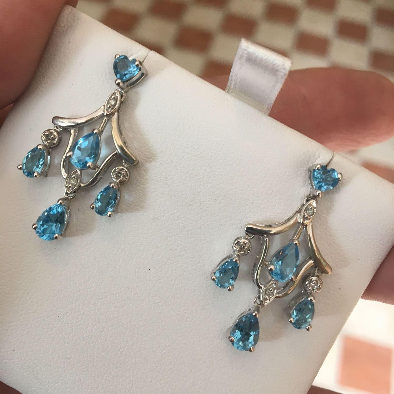 Lovely 14k white gold blue topaz diamond chandelier earrings aloadofball Image collections