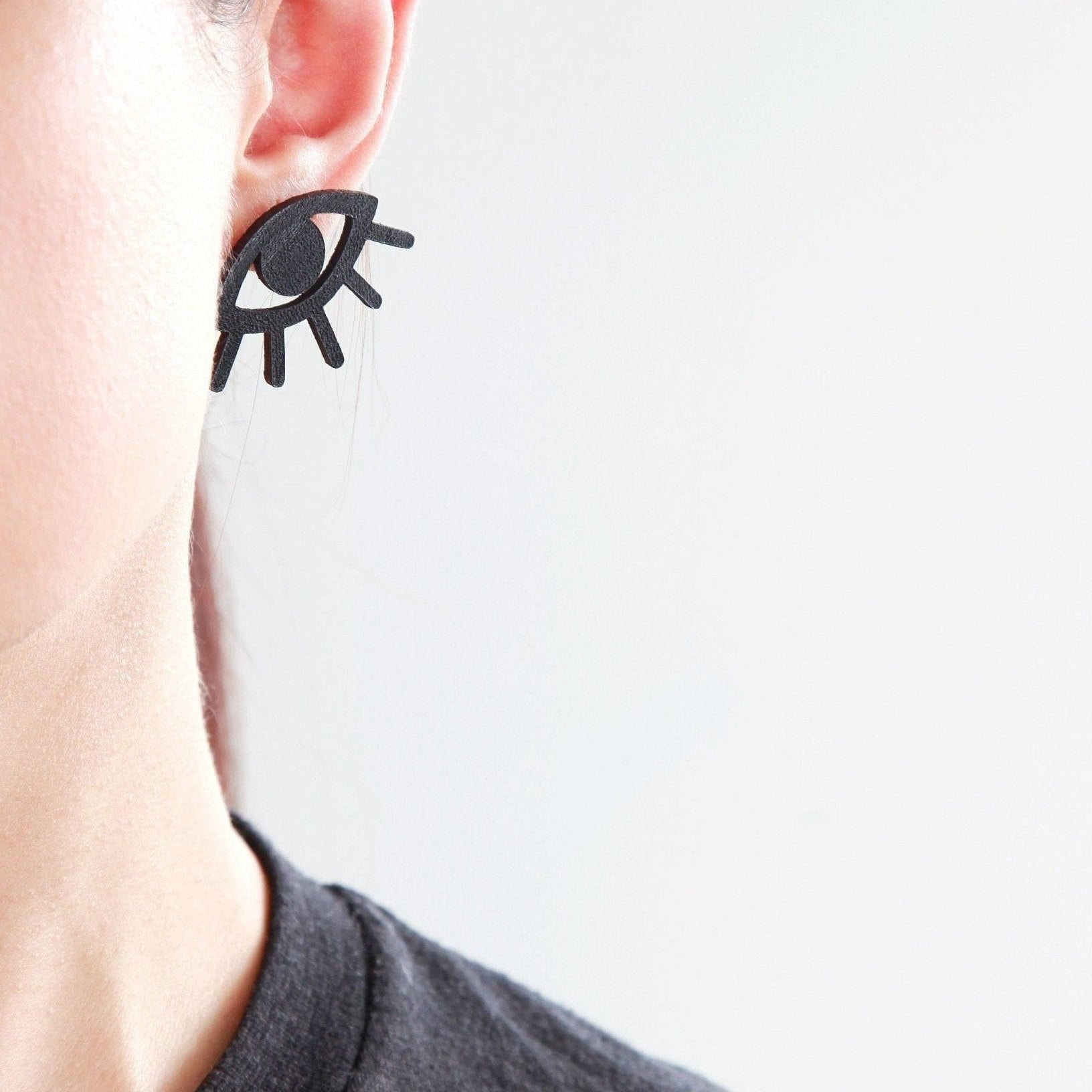 64b988d65 Black eye eyelashes leather stud earrings | Illuminati earrings | Evil ...