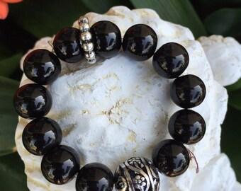 Black stretch filigree bracelet