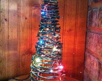 barbed wire christmas tree with lights