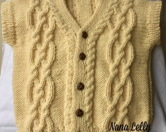 Child Aran Waistcoat, Gilet, Cable Knit Sleeveless Sweater, Button Down Vest Top. Natural Cream Aran Yarn Handknitted in UK.