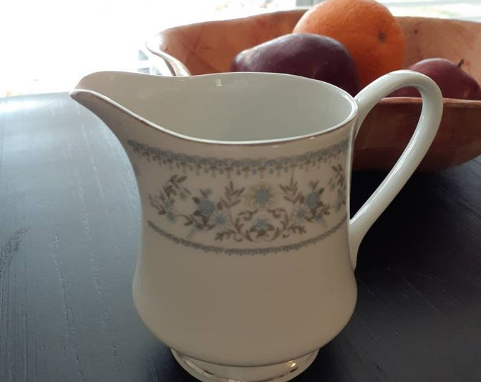 Creamer elegant silver accented