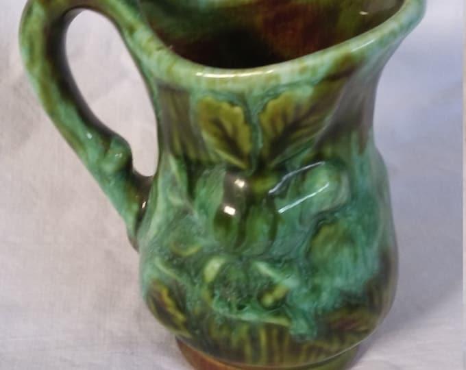 Miniature green ceramic vase