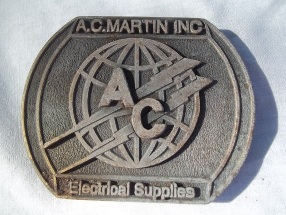 BRASS BELT BUCKLE 1970s Electrical Supplies A.C. Martin Inc. Vintage
