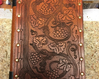 Sketch book with custom leather cover.