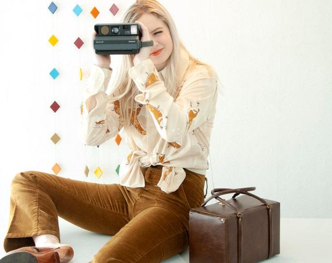 Vintage Polaroid camera set, case and film, brown vinyl retro 1970s gift