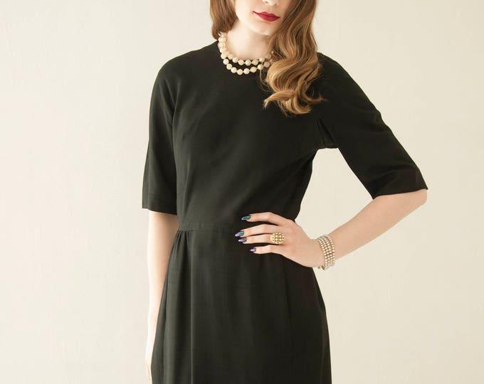 Vintage 1960s black shift dress, half-sleeves, pockets, knee-length mod formal LBD, S