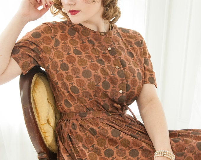 Vintage 1950s astrolabe dress, brown novelty print dots short sleeve fit flare cotton knee-length midi pin-up L 1940s Ann Taylor