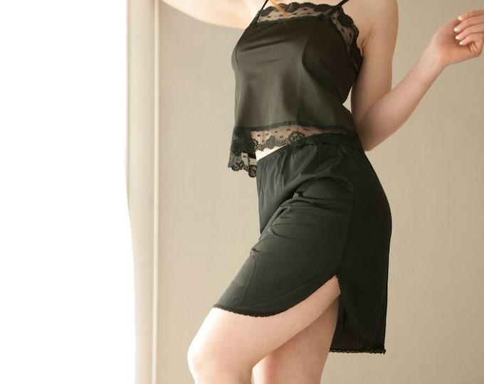 Vintage short black slip skirt, nylon half mini, lace high side vent slit, lingerie 1980s