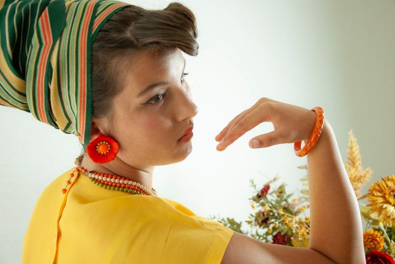 Vintage orange Bakelite bangle bracelet carved floral flowers image 0
