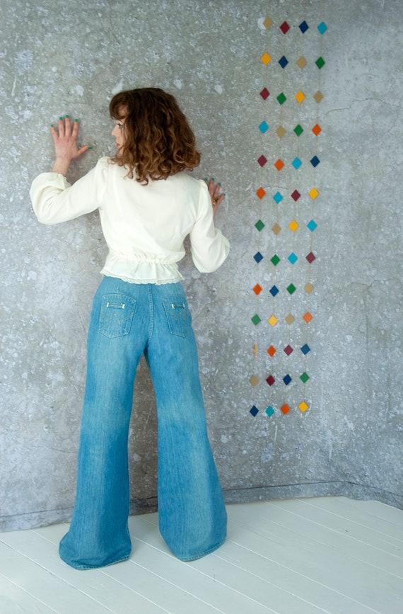 Vintage bell bottom jeans, faded light blue denim