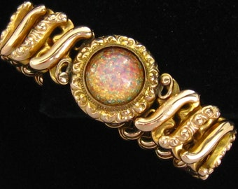 Repaired Sweetheart Expansion Bracelet.  Gold Filled Band with Replacement Art Glass Foiled Opal Cabochon Focal Stone.  Gold Filled.