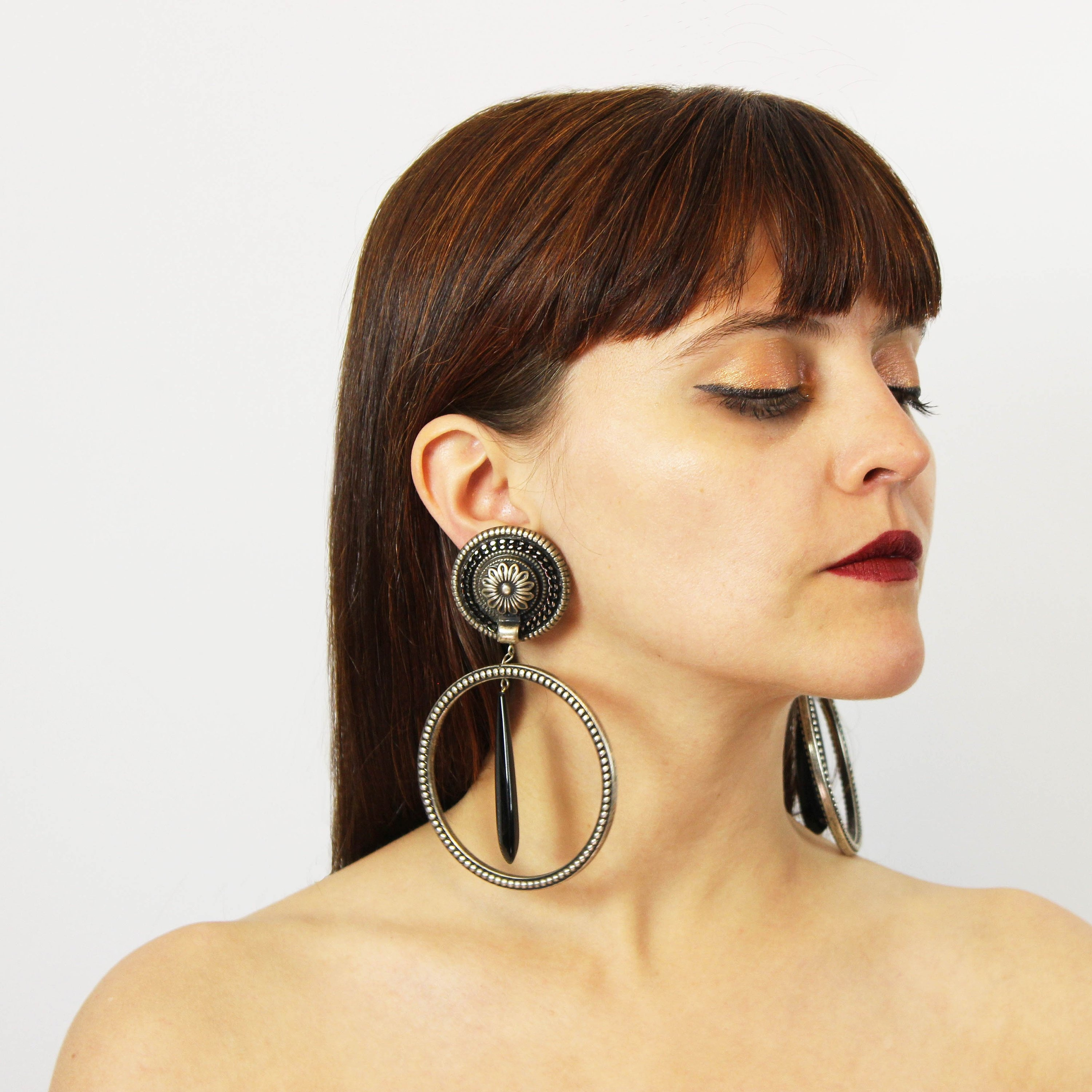 Check Out The Bizarre Earrings In Mugler's Pre-Fall 2013Collection