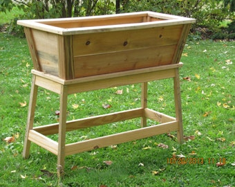 Wooden Outdoor Planter For Container Gardening At An Easy Reach Level