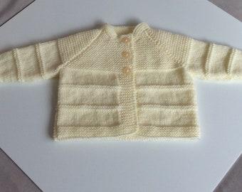 Hand knitted cream baby cardigan
