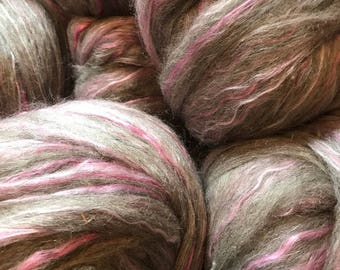 Absolutely gorgeous grey mohair/Columbia roving with pink bamboo!!