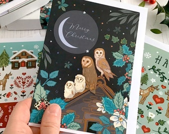 Merry Christmas card featuring barn owl family and crescent moon