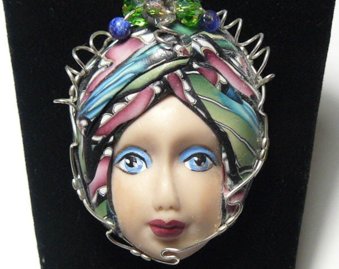 "Polymer Clay Art Doll Face wire wrapped pendant, 1 1/2"" wide, 2 1/4"" long, Argentium silver wire, natural and glass beads (j53109)"