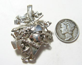 Sterling Silver artistic abstract pendant from my bench, using my SS scrap.  (J42811)