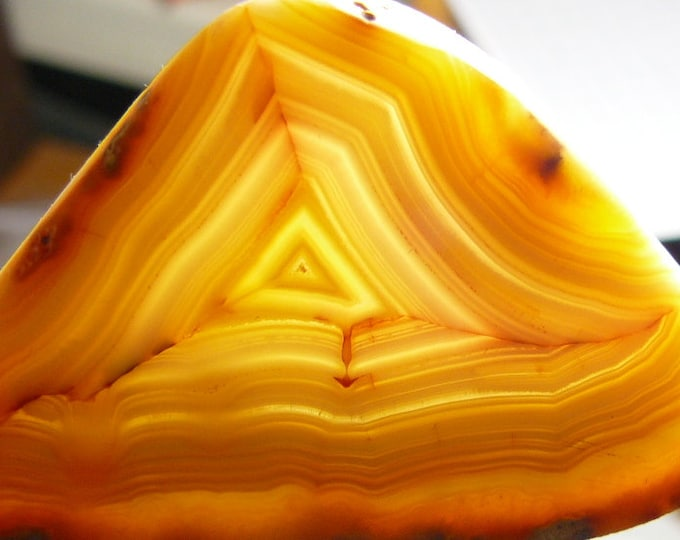 Brazilian banded agate, translucent carnelian color. 33 x 51 x 5 mm. preformed rough agate slice.  (rs31614)
