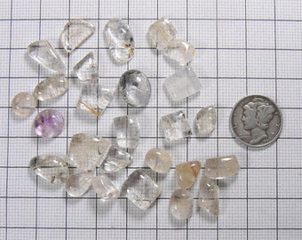 27 small Rutilated  Quartz cabs, for accent stones, rings or a special jewelry creation, they all have internal inclusions  (c61815)