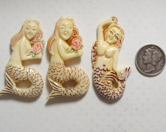 3 carved bone Mermaids, 2 holding a rose and 1 holding a pearl,  jewelry supply, hand carved in India, drilled hole.  (j71006 )