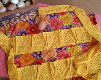 Egg apron / for gathering 12 deep pleated pockets backstitched for durability eggs won't bump and hands are free most 20x20long tie. Cotton