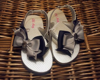 59af796257a Metallic Silver   Black Toddler Flip Flop Sizes  8 (1 left)