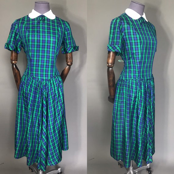 Plaid 1940s day dress on blue and green