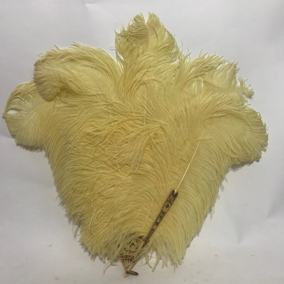 1920s 1930s ostrich feather fan with yellow feathe