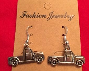 Silver tone truck earrings