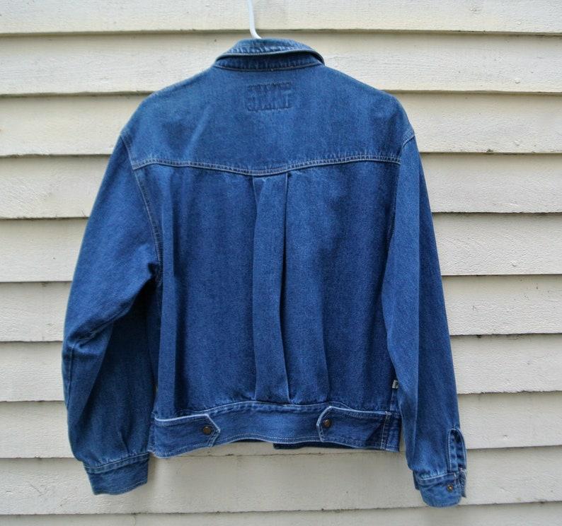 Unisex Jean Jacket Vintage 80s jean jacket with snap closures   Baby blue jean denim jacket in a size medium