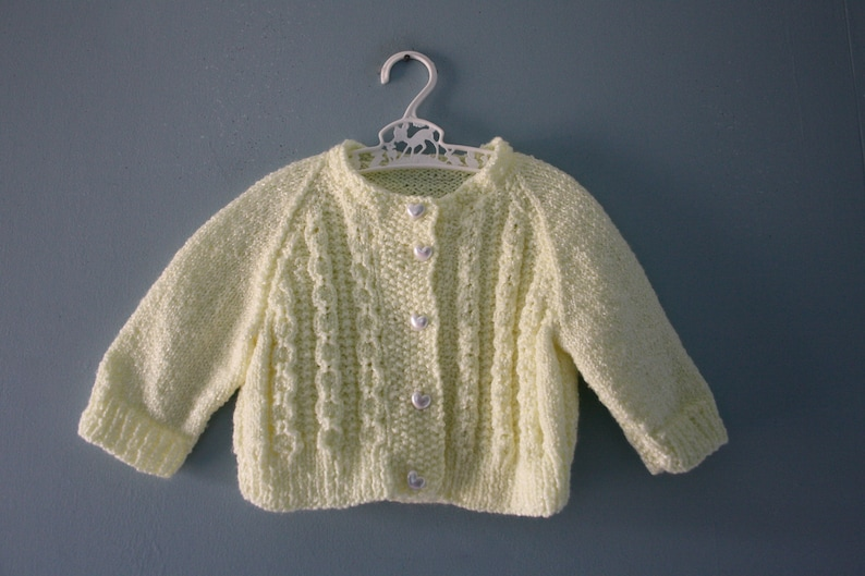05f346d5b Vintage handknit baby cardigan sweater   pale yellow knit