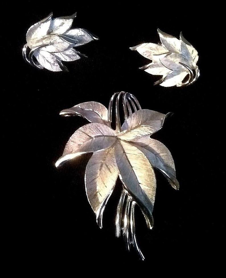 Vintage Crown Trifari brushed silver leaf brooch and earrings demi parure
