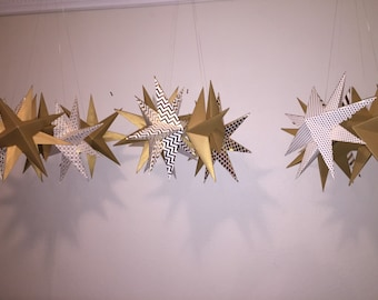 Gold or silver paper hanging stars