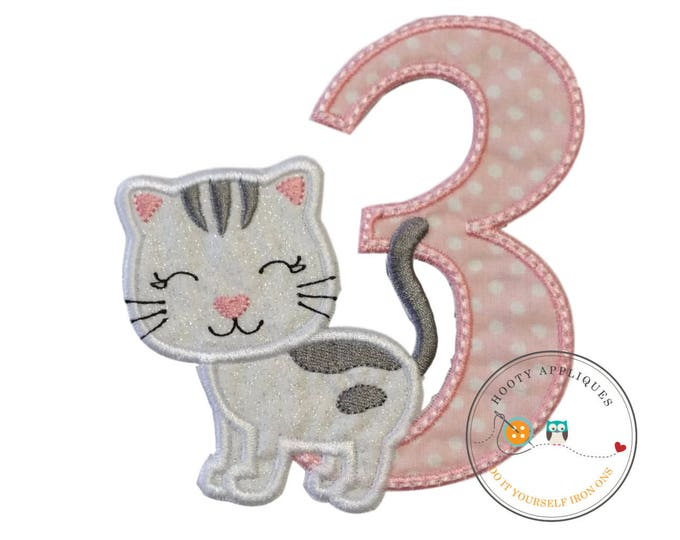 Kitty number three birthday iron-on applique in white and pink dots and white glittered fabric kitten, gray embroidered stripes, pink nose