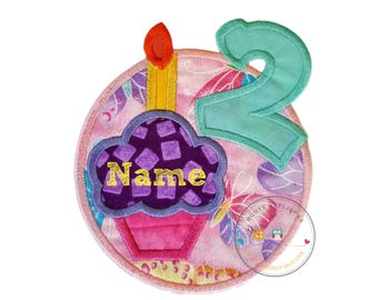 Number two birthday cupcake iron-on applique with appliqued, teal number 2 and butterfly background, purple cupcake on pink, yellow candle