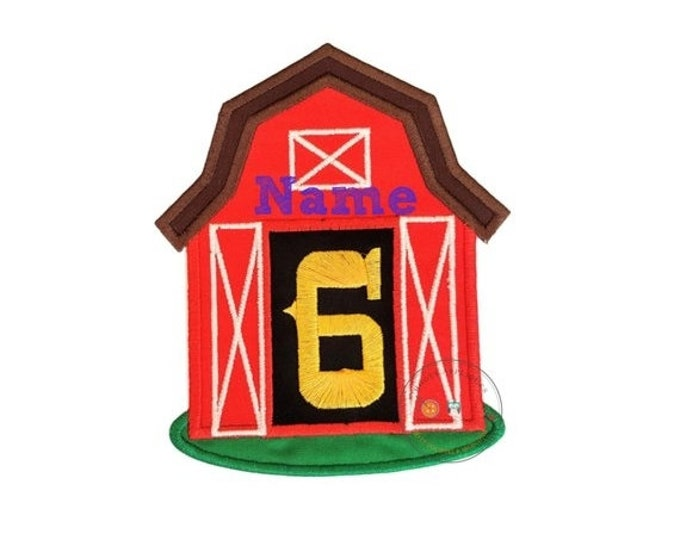 LIQUIDATION SALE Red, country barn iron on applique with open doors displaying a big, yellow, birthday number 6 on top of a black back groun