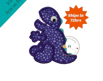 Purple polka-dotted dino with teal spikes, trimmed in purple embroidery thread, bright dinosaur patch, embroidery details, for boy or girl