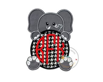 Gray elephant holding large monogrammed, houndstooth-printed ball iron-on applique, white embroidered tusk, eyes and nails trimmed in gray