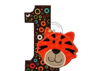 ON SALE Tiger number one birthday iron on in bright orange with black stripes on top of modern, circle print fabric with brown background